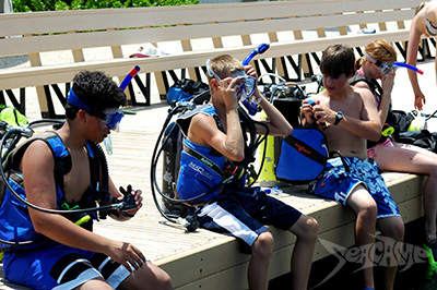 Campers preparing gear before a dive at Seacamp