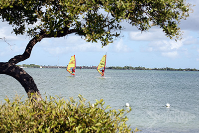 Campers windsurfing in Newfound Harbor at Seacamp